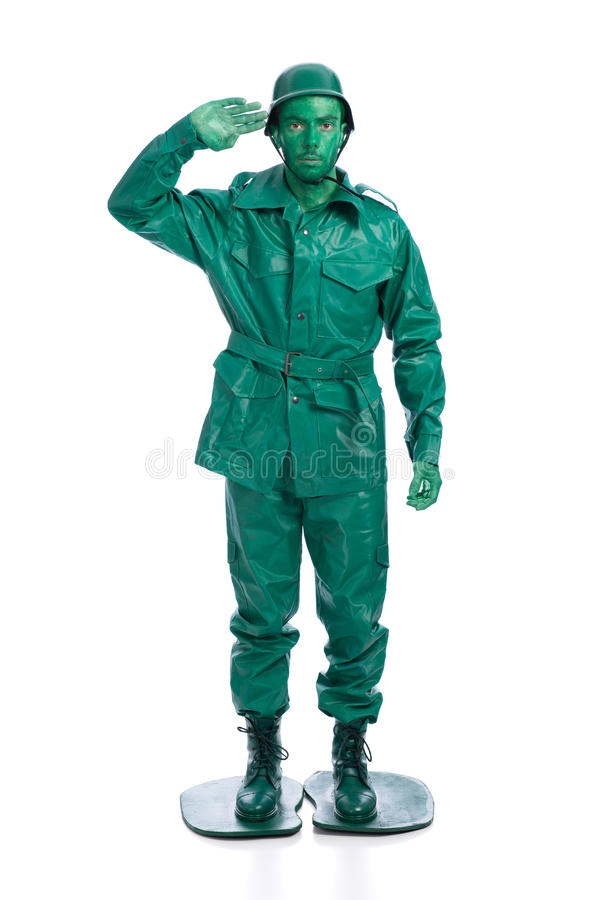 Άτομο σε ένα πράσινο κοστούμι στρατιωτών παιχνιδιών στοκ φωτογραφία με δικαίωμα ελεύθερης χρήσης
