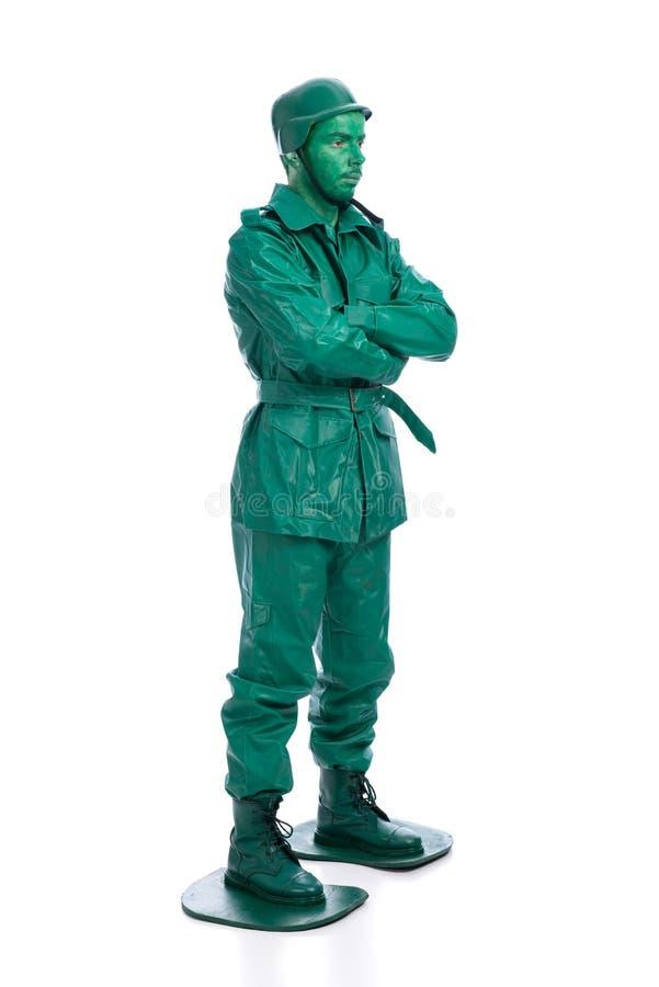 Άτομο σε ένα πράσινο κοστούμι στρατιωτών παιχνιδιών στοκ εικόνα με δικαίωμα ελεύθερης χρήσης