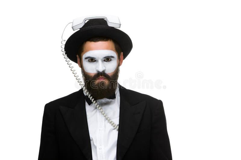 Άτομο στην εικόνα mime που κρατά ένα μικροτηλέφωνο στοκ φωτογραφίες με δικαίωμα ελεύθερης χρήσης
