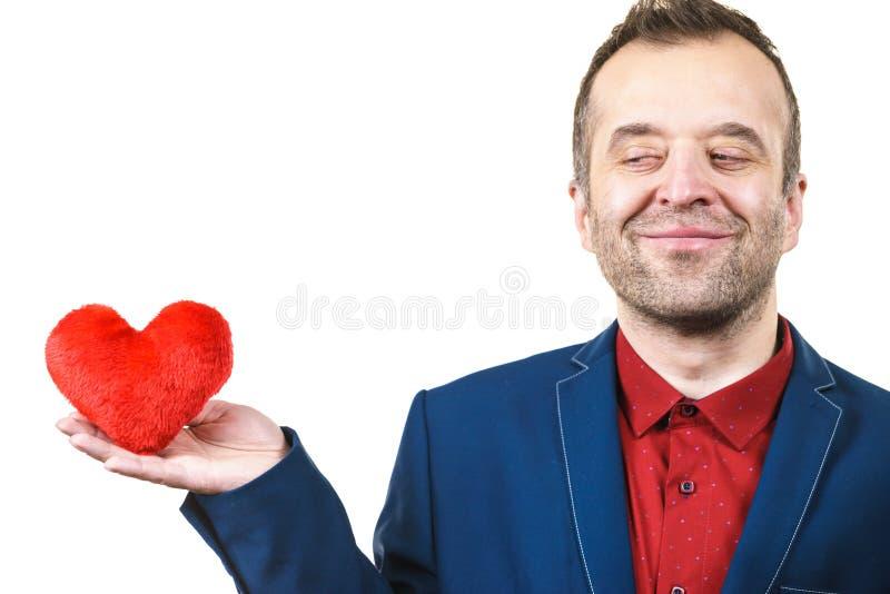 Άτομο στην καρδιά εκμετάλλευσης κοστουμιών στοκ φωτογραφίες με δικαίωμα ελεύθερης χρήσης