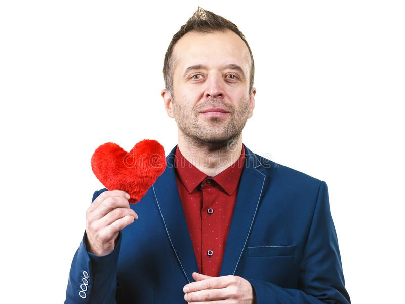 Άτομο στην καρδιά εκμετάλλευσης κοστουμιών στοκ εικόνες