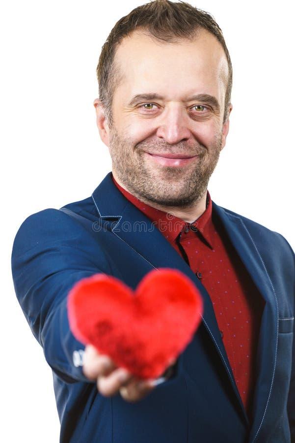Άτομο στην καρδιά εκμετάλλευσης κοστουμιών στοκ φωτογραφία με δικαίωμα ελεύθερης χρήσης