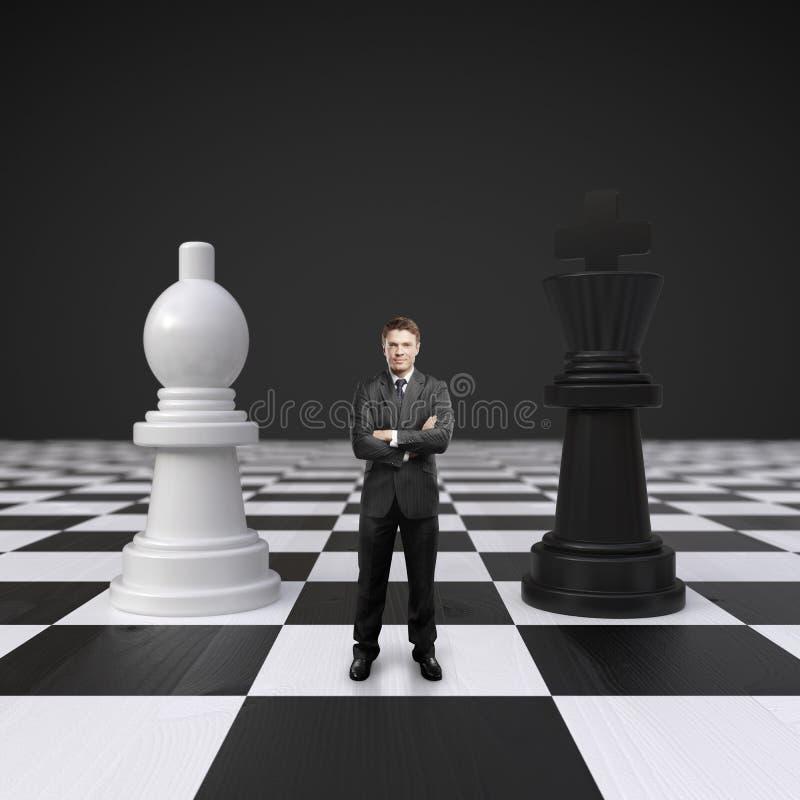 Άτομο στη σκακιέρα στοκ εικόνες