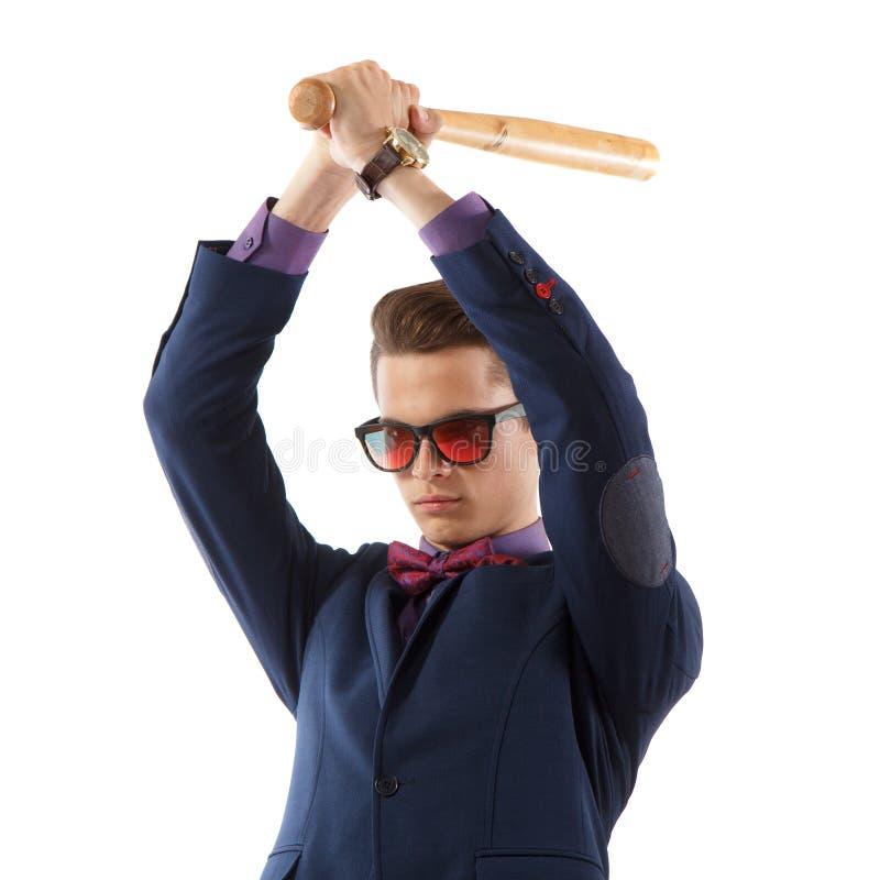 Άτομο στο κοστούμι με το ρόπαλο του μπέιζμπολ στοκ εικόνες
