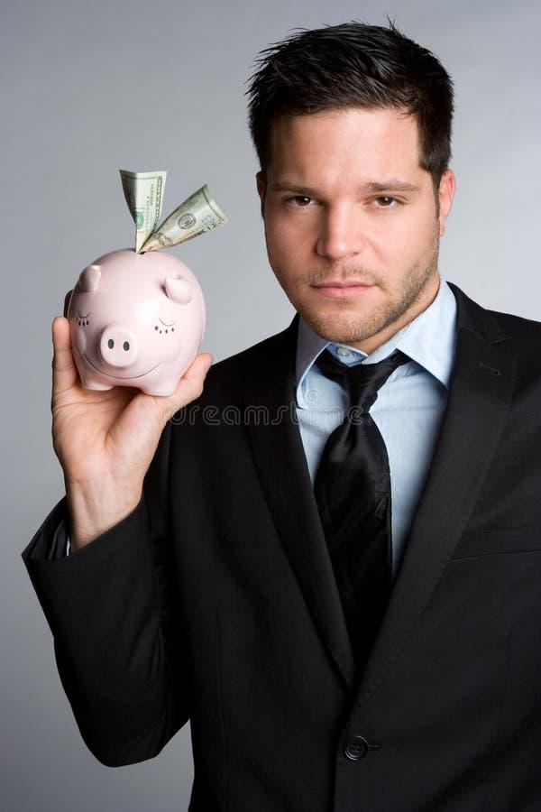 άτομο τραπεζών piggy στοκ εικόνα με δικαίωμα ελεύθερης χρήσης