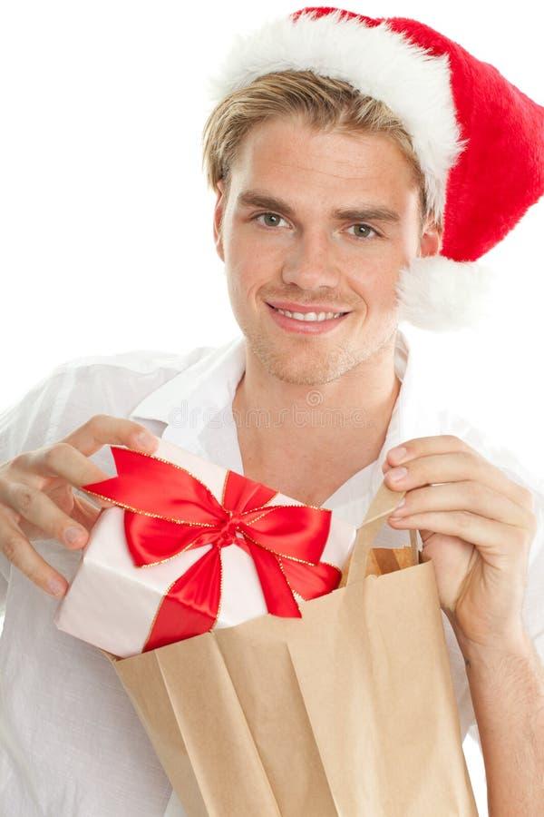 Άτομο Χριστουγέννων με την τσάντα στοκ εικόνες