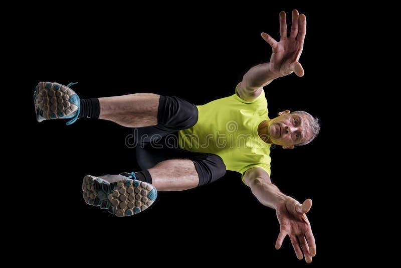 Άτομο, 48 χρονών, σε ένα sprintstart στο στίβο στοκ φωτογραφίες με δικαίωμα ελεύθερης χρήσης