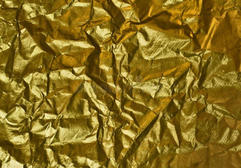 έγγραφο που ζαρώνεται χρυσό στοκ εικόνες
