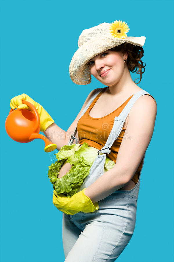 Έγκυος γυναίκα και η κοιλιά της ως λάχανο στοκ φωτογραφία με δικαίωμα ελεύθερης χρήσης