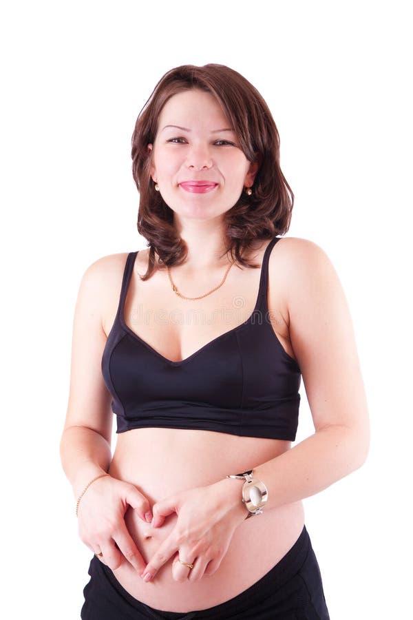 Έγκυος γυναίκα, που απομονώνεται ευτυχής στο λευκό στοκ φωτογραφία