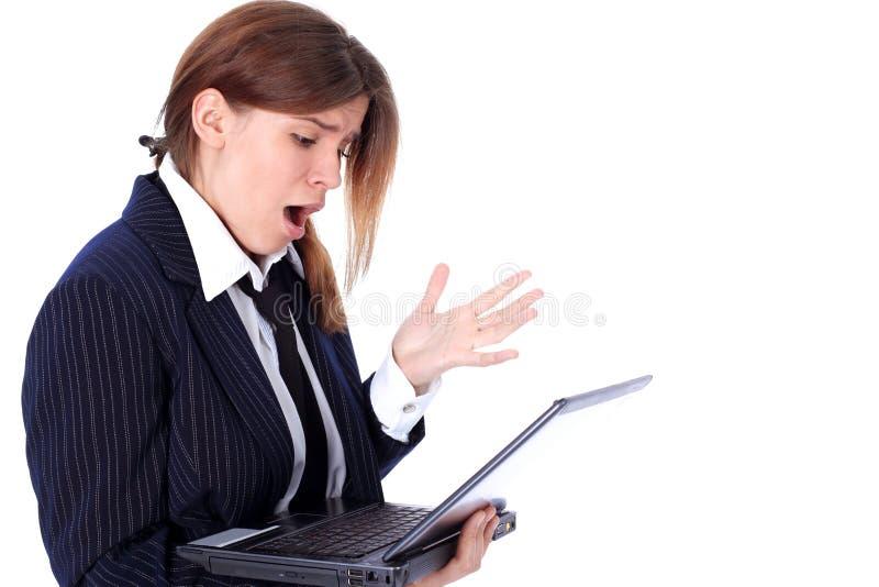 Έκπληξη - επιχειρησιακή γυναίκα με το lap-top στοκ φωτογραφίες