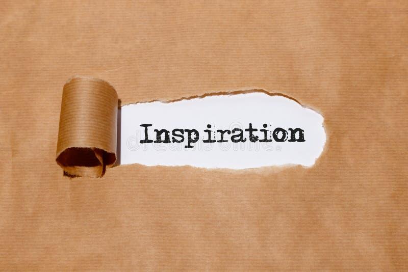 ` Έμπνευση ` πίσω από το σχισμένο έγγραφο στοκ φωτογραφία με δικαίωμα ελεύθερης χρήσης