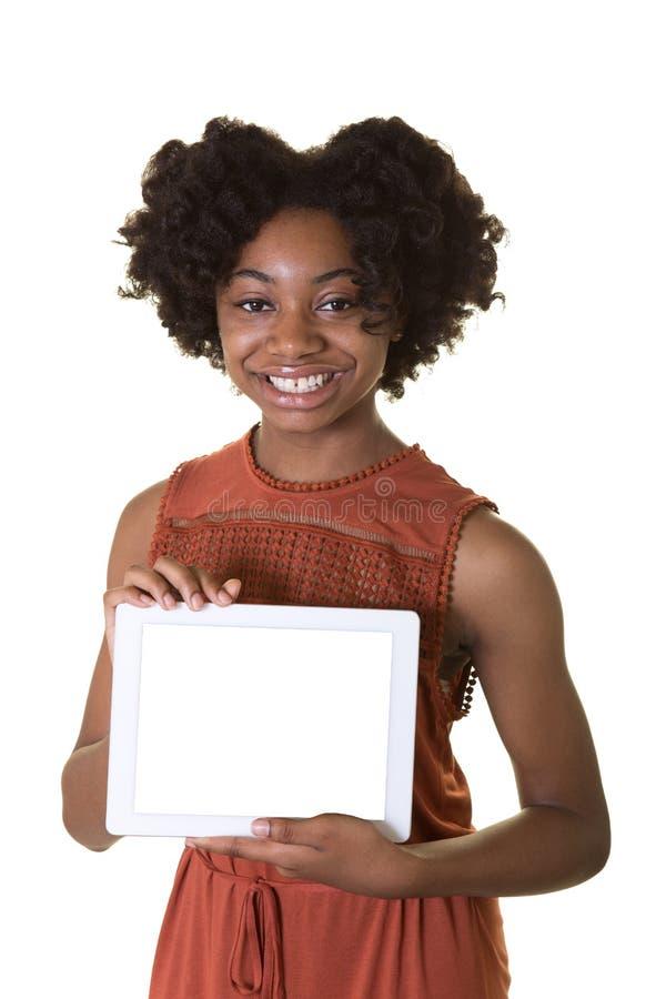 Ένας έφηβος που κρατά μια ταμπλέτα στοκ εικόνες