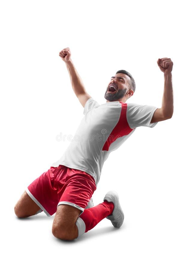 Ένας επαγγελματικός ποδοσφαιριστής με μια σφαίρα στα χέρια του Όψη από πίσω η ανασκόπηση απομόνωσε το λευκό στοκ εικόνες