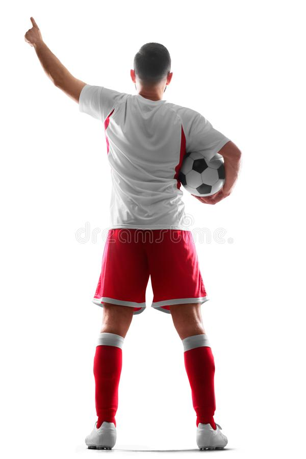 Ένας επαγγελματικός ποδοσφαιριστής με μια σφαίρα στα χέρια του Όψη από πίσω η ανασκόπηση απομόνωσε το λευκό στοκ εικόνα