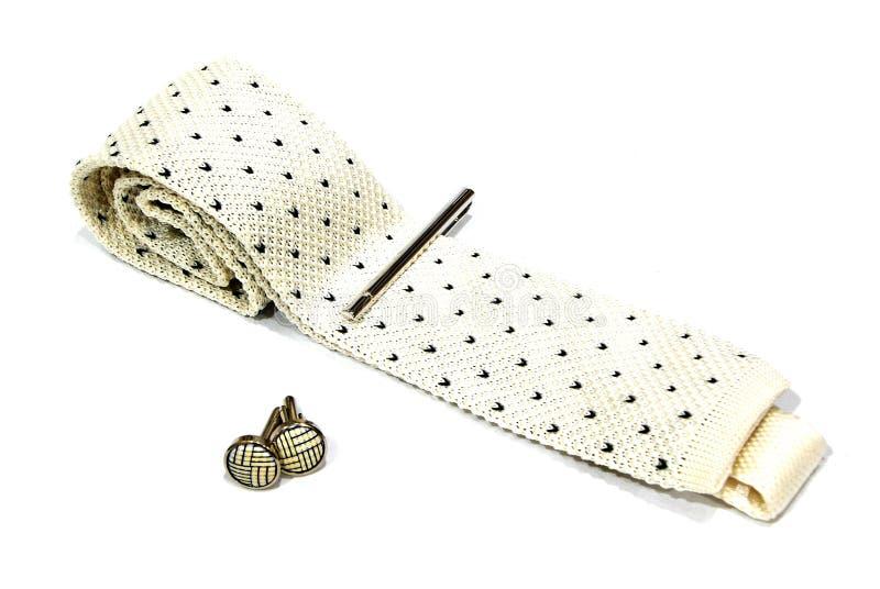 Ένας δεσμός, μια καρφίτσα γραβάτας και ένα μανικετόκουμπο στοκ εικόνες