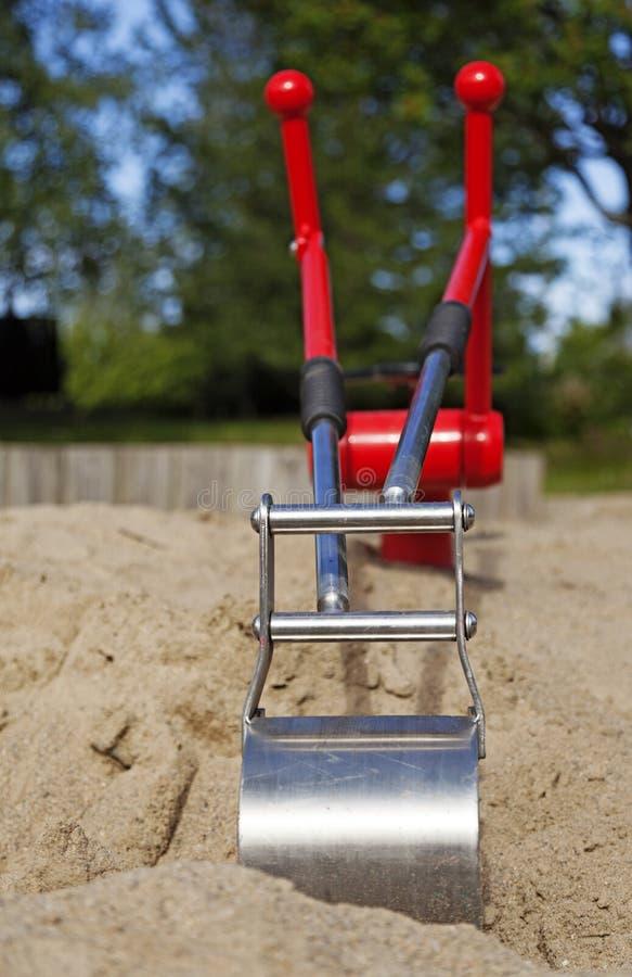 Ένας νέος εκσκαφέας παιχνιδιών στο Sandbox στοκ εικόνες με δικαίωμα ελεύθερης χρήσης