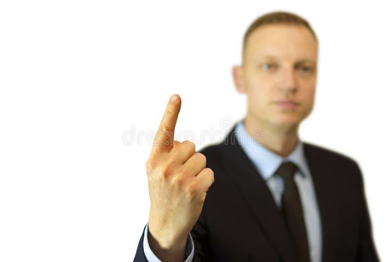 Ένας νέος και όμορφος επιχειρηματίας που δείχνει επάνω με το δάχτυλό του στοκ φωτογραφία
