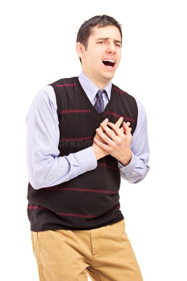 Ένας νεαρός άνδρας που έχει μια επίθεση καρδιών στοκ εικόνα με δικαίωμα ελεύθερης χρήσης