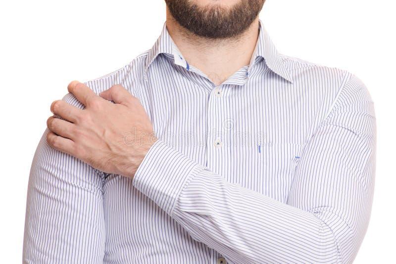 Ένα άτομο βλάπτει τον ώμο του στοκ φωτογραφία με δικαίωμα ελεύθερης χρήσης