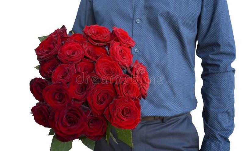 Ένα άτομο κρατά μια ανθοδέσμη στο χέρι του - 21 κόκκινα τριαντάφυλλα εικόνα στοκ φωτογραφία με δικαίωμα ελεύθερης χρήσης