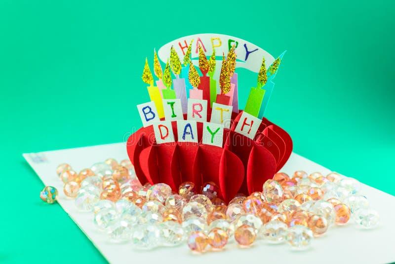 Ένα έγγραφο cupcake με ένα κερί στοκ φωτογραφία