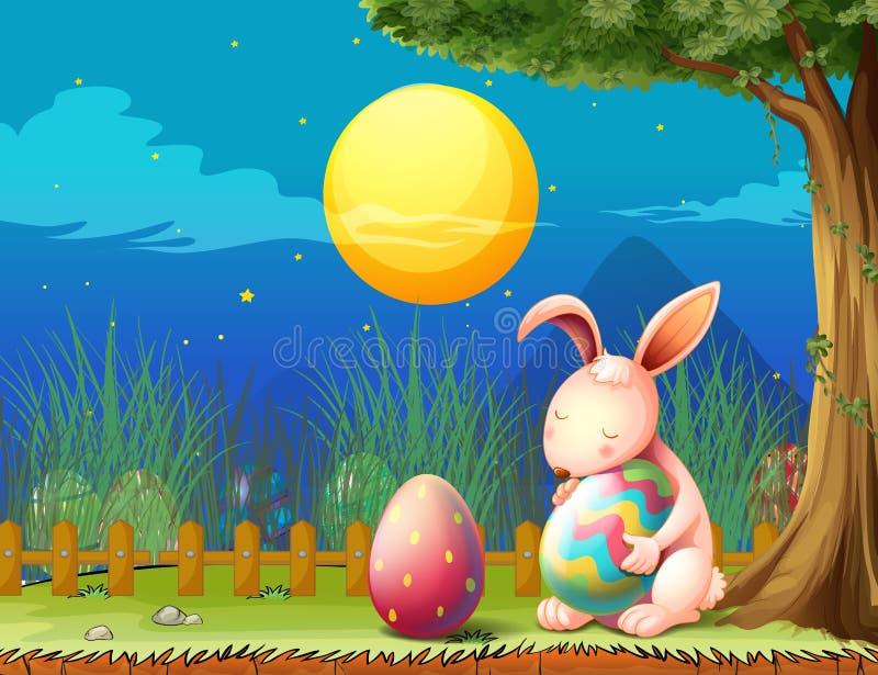Ένα λαγουδάκι στο φράκτη με δύο αυγά Πάσχας απεικόνιση αποθεμάτων