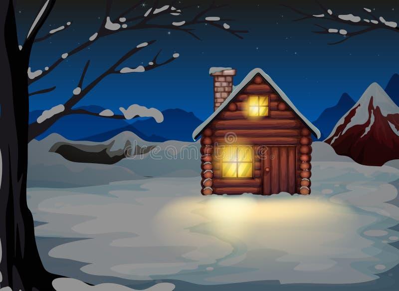 Ένα αναμμένο σπίτι κούτσουρων στο χιονώδες έδαφος απεικόνιση αποθεμάτων