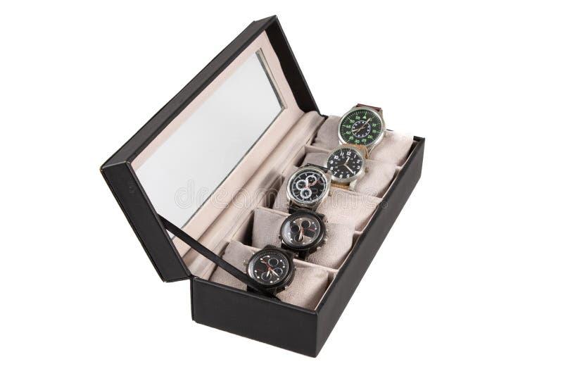Ένα ανοικτό μαύρο κιβώτιο δώρων με το ρολόι πολυτέλειας στο άσπρο υπόβαθρο που απομονώνεται στοκ φωτογραφίες