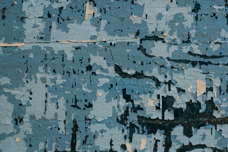 Ένα αρχαίο υπόβαθρο υπό μορφή ξύλινης σύστασης με ένα shabby ξεπερασμένο χρώμα των διαφορετικών χρωμάτων Εκλεκτής ποιότητας επίστ στοκ φωτογραφία με δικαίωμα ελεύθερης χρήσης