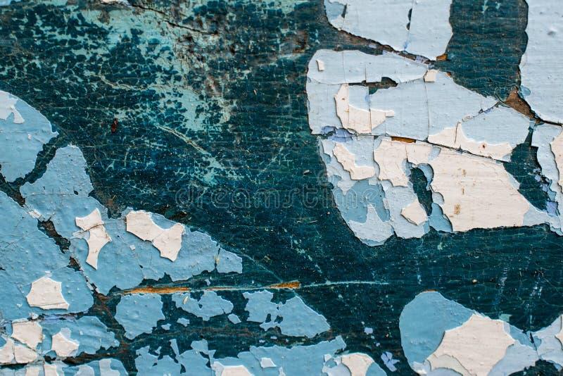 Ένα αρχαίο υπόβαθρο υπό μορφή ξύλινης σύστασης με ένα shabby ξεπερασμένο χρώμα των διαφορετικών χρωμάτων Εκλεκτής ποιότητας επίστ στοκ εικόνες