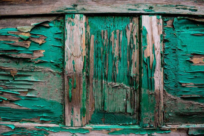 Ένα αρχαίο υπόβαθρο υπό μορφή ξύλινης σύστασης με ένα shabby ξεπερασμένο χρώμα των διαφορετικών χρωμάτων Εκλεκτής ποιότητας επίστ στοκ φωτογραφία