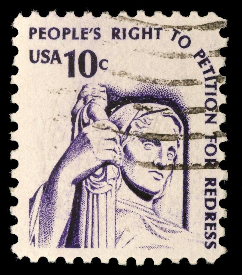 Ένα γραμματόσημο που τυπώνεται στις ΗΠΑ παρουσιάζει σχέδιο της δικαιοσύνης στοκ εικόνες
