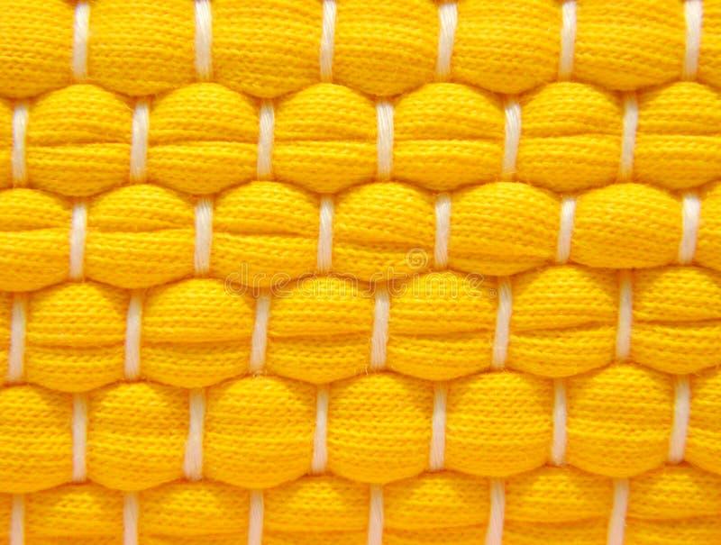 Ένα δείγμα της κίτρινης ύφανσης βαμβακιού στοκ φωτογραφία