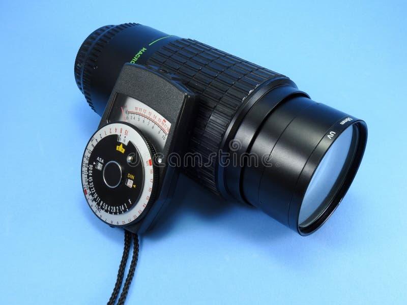Ένα εκλεκτής ποιότητας φωτόμετρο και ένας φακός ζουμ για τη κάμερα SLR στοκ φωτογραφία