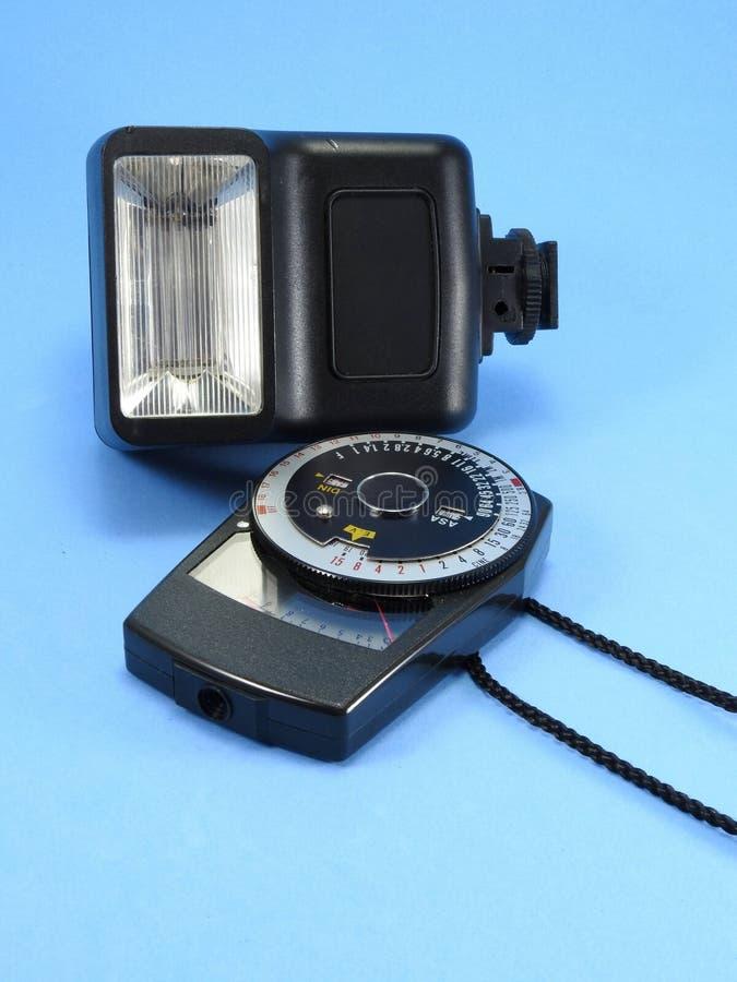 Ένα εκλεκτής ποιότητας φωτόμετρο και μια παλαιά λάμψη καμερών φωτογραφιών στοκ εικόνες με δικαίωμα ελεύθερης χρήσης