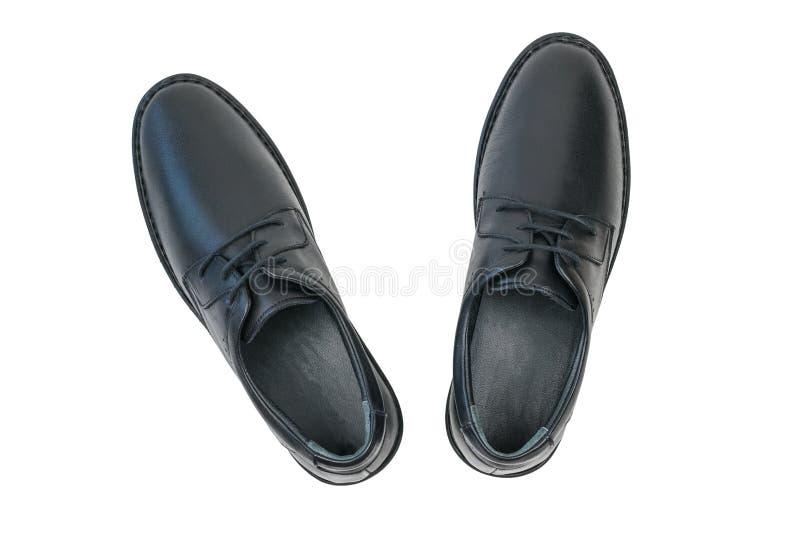 Ένα ζευγάρι των παπουτσιών των μαύρων ατόμων δέρματος που απομονώνεται στο άσπρο υπόβαθρο r στοκ φωτογραφία με δικαίωμα ελεύθερης χρήσης
