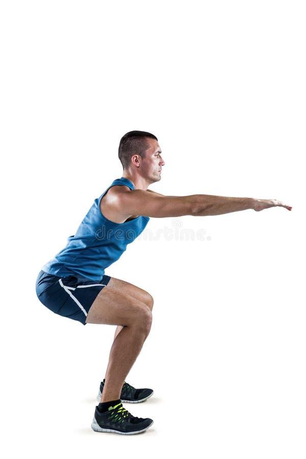 Ένα κατάλληλο άτομο που κάνει τις στάσεις οκλαδόν στοκ φωτογραφία με δικαίωμα ελεύθερης χρήσης