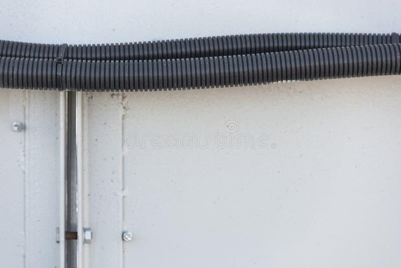 Ένα κομμάτι της μαύρης ζαρωμένης μάνικας είναι στενό στοκ φωτογραφίες