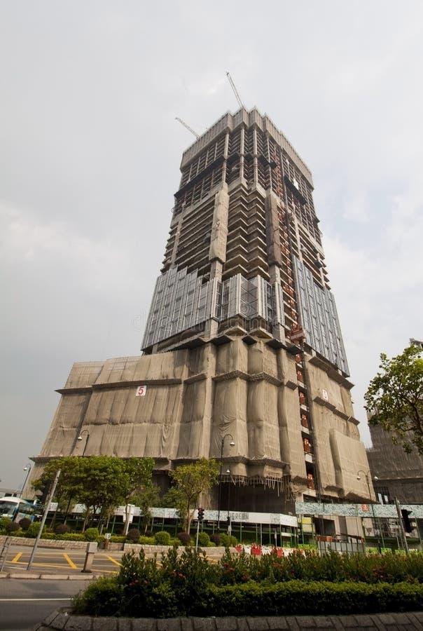 Ένα κτήριο κάτω από την οικοδόμηση στο Χογκ Κογκ στοκ εικόνες