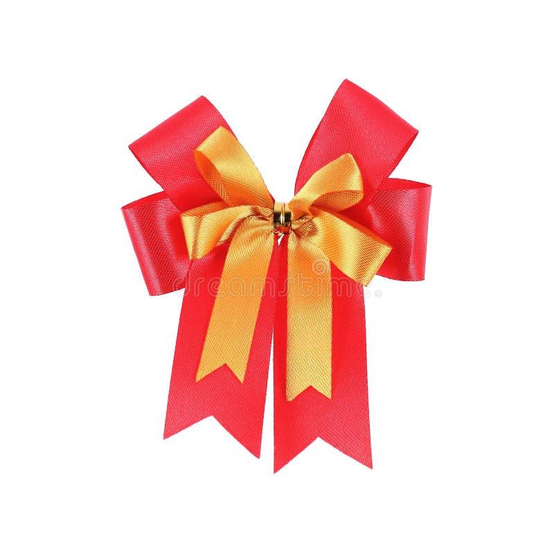 ένα κόκκινο και κίτρινο τόξο δώρων που απομονώνεται στο λευκό στοκ φωτογραφία με δικαίωμα ελεύθερης χρήσης