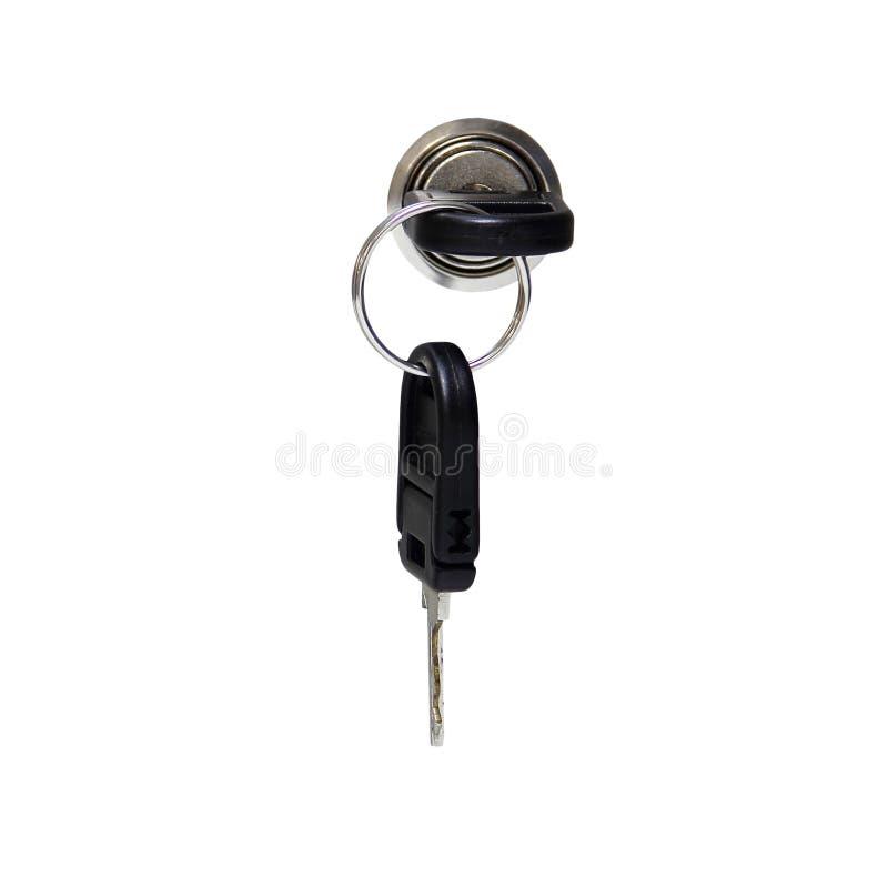 Ένα κλειδί στην κλειδαρότρυπα με το κλείσιμο ενός γραφείου στοκ εικόνα με δικαίωμα ελεύθερης χρήσης