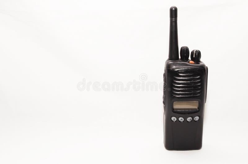 Ένα μαύρο διπλής κατεύθυνσης ραδιόφωνο σε ένα άσπρο υπόβαθρο στοκ εικόνες με δικαίωμα ελεύθερης χρήσης