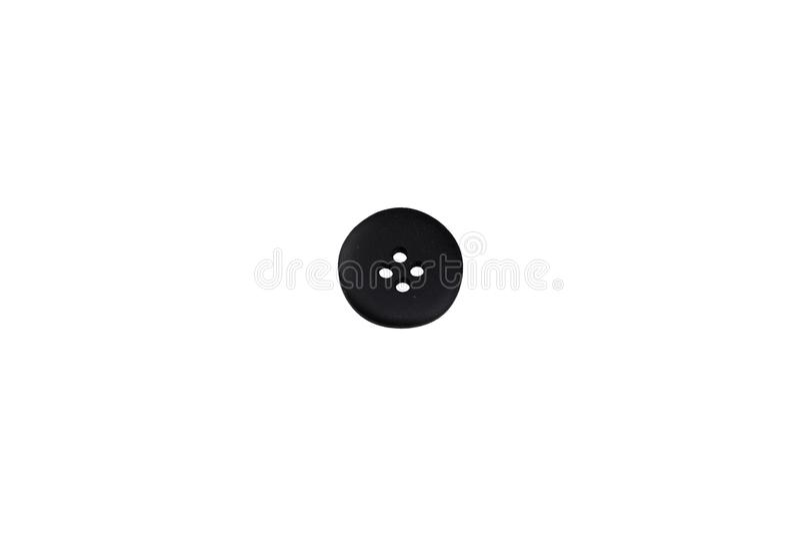 Ένα μαύρο κουμπί ιματισμού απομονώνει στοκ φωτογραφίες με δικαίωμα ελεύθερης χρήσης