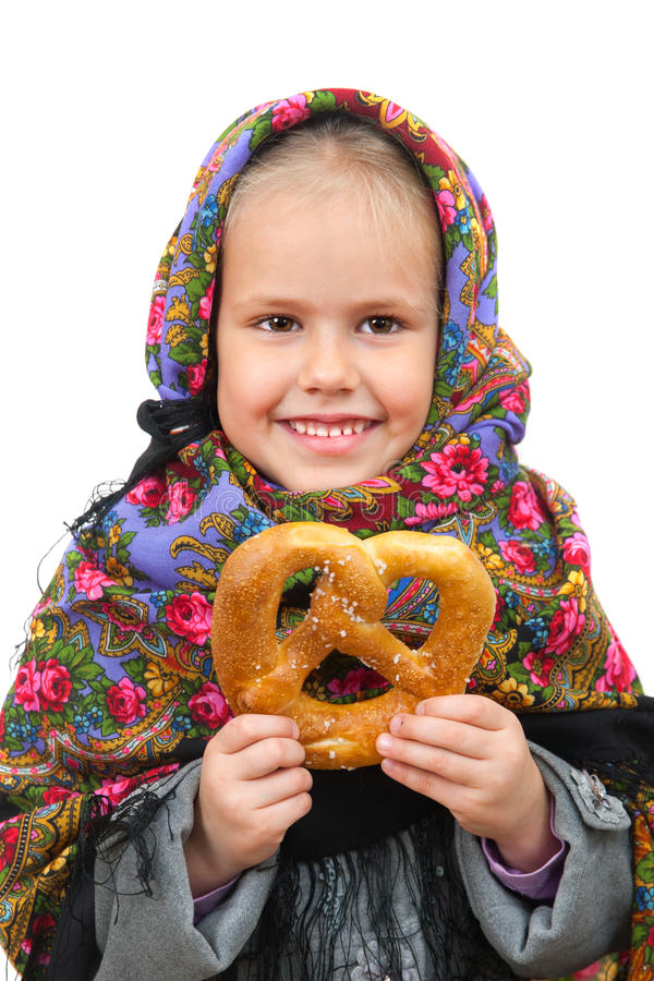 Ένα μικρό κορίτσι με ένα μπισκότο στοκ εικόνες
