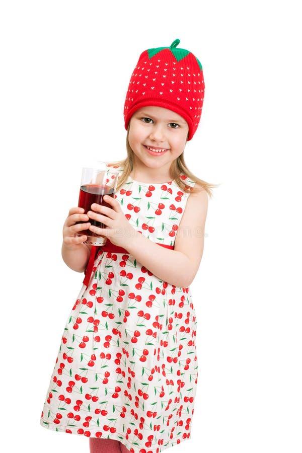 Ένα μικρό κορίτσι με το ποτήρι του χυμού στοκ εικόνες