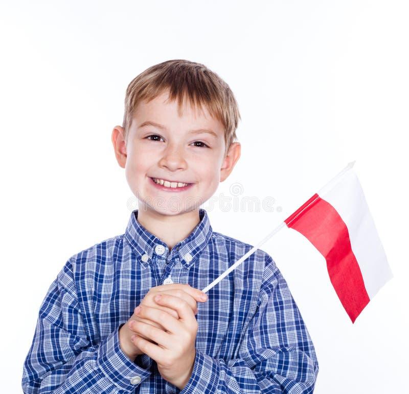 Ένα μικρό παιδί με την πολωνική σημαία στοκ εικόνα