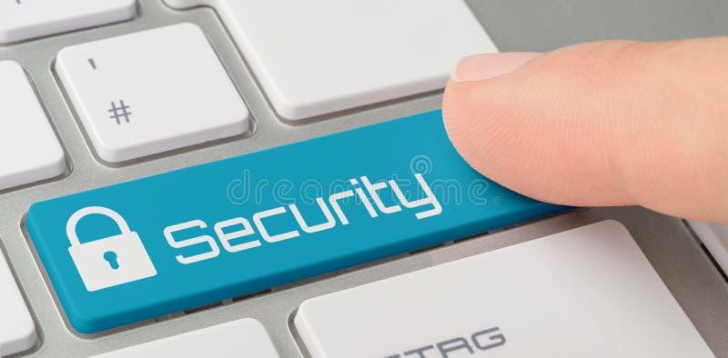 Ένα πληκτρολόγιο με ένα μπλε επονομαζόμενο κουμπί - ασφάλεια στοκ εικόνες
