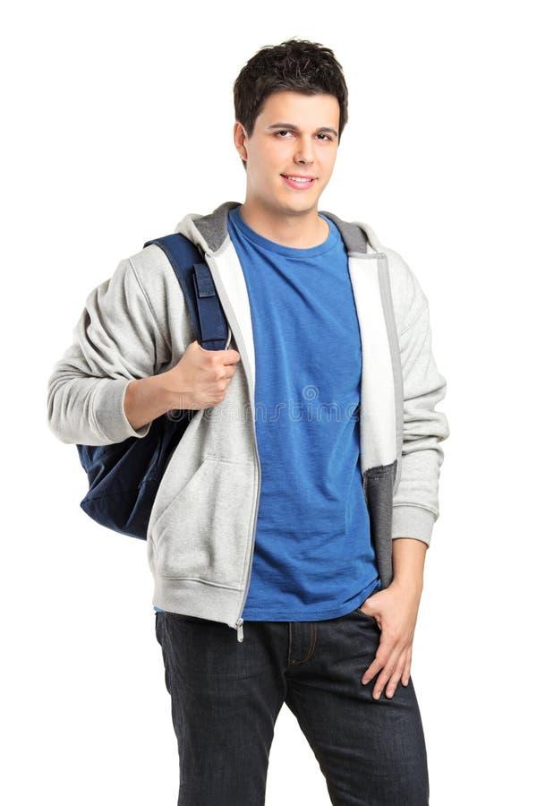 Ένα πορτρέτο ενός άνδρα σπουδαστή με μια σχολική τσάντα στοκ φωτογραφία με δικαίωμα ελεύθερης χρήσης