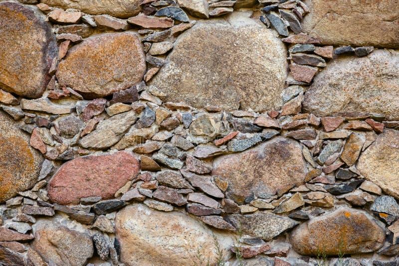 Ένα τεμάχιο ενός παλαιού τοίχου πετρών στοκ εικόνες με δικαίωμα ελεύθερης χρήσης